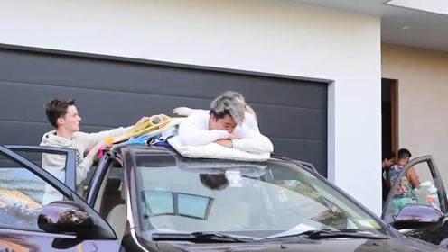 国外小伙作死挑战,居然将好友绑在车顶,还带他开车上路