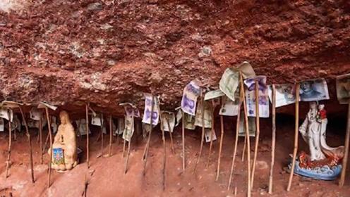 中国一座神秘的山崖,洞里放着成堆的钱,却无人敢拿走!