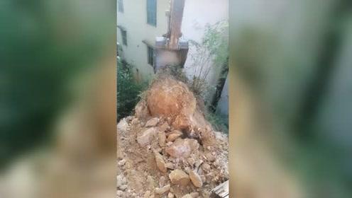 挖到一块大石头不敢动,下面有楼房,求大神支招!