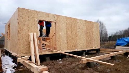 国外农村盖房子,不用一颗砖块,这木块搭建起来一定很保暖