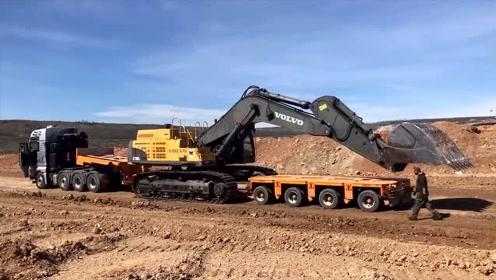 拖车运输挖掘机,看看挖掘机是如何上拖车的,新手看一次就会了
