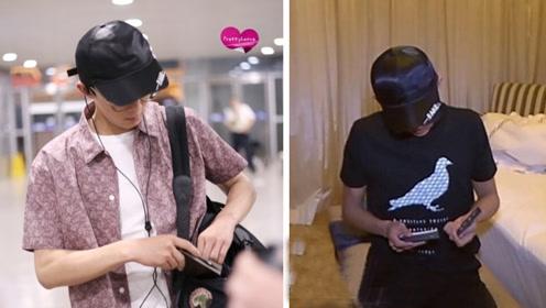 吴磊机场帅气亮相 帽子撞张一山啦!