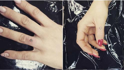 美国00后订婚戒指玩出新花样 直接将钻石镶嵌进手指