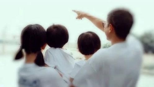 谢娜分享一家四口白色T恤全家福,与张杰一人抱一娃超幸福