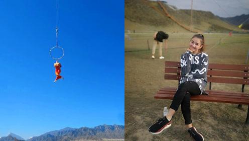 胆颤心惊!17岁少女用牙齿咬住吊环,6米高空旋转如陀螺