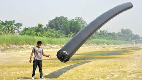 小伙好奇实验,让巨大塑料袋飞上了天,这个什么原理?