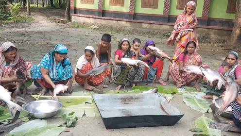 村民聚餐拿来66斤鱼,抹上咖喱炸一炸,一口饭一口鱼香得很