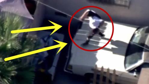 """警察抓小偷时,突然遇到""""跑酷高手""""女子爬上房顶来去自如!"""