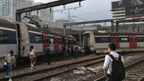 港铁红磡站一列车脱轨 有车门爆开飞脱