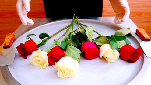 小伙子把玫瑰花放进锅里炒,出锅就卖75元一份,每天出摊不够卖
