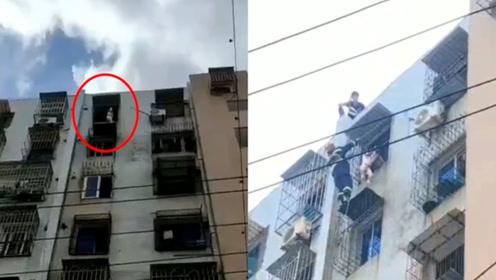 惊险!浙江一幼童头卡顶楼防盗网身体悬空,消防员悬索救回