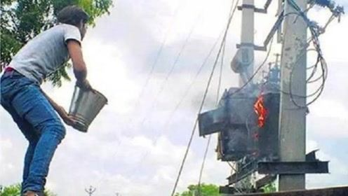 印度电工不愧是强悍的,徒手接电,高空走钢丝,变压器着火用水浇