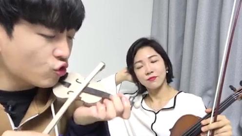 男子表情严肃用嘴拉小提琴,小提琴确实纸壳做的,小编:太有才了