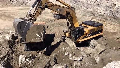国外工地实拍,大型卡特挖掘机挖土装车