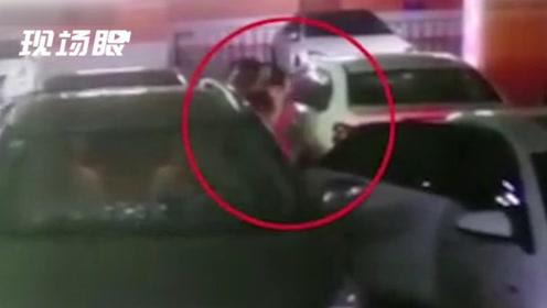 女子在车库遭蒙面男强行拖拽上车 警方:双方因矛盾纠纷引发