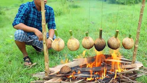 印度版椰子鸡,将鸡肉塞进椰子中,吊在火上烤,香味扑鼻而来!