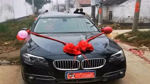 村长请了8辆宝马给儿子当婚车,简直太有排面了,真是个好父亲!