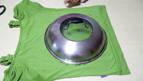 小姑娘太有创意了,旧衣服上面放个锅盖,做成它给孩子玩真不错