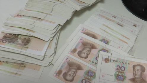 没钱花?自己造!男子为还贷款用打印机伪造假币 没来得及花就被抓