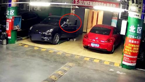 保时捷女司机地下车库遭陌生男子持刀劫持 监控拍下惊险全程