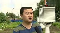黑龙江七台河惊现陆地龙卷风 巨大风柱卷沙尘黑云蔽天