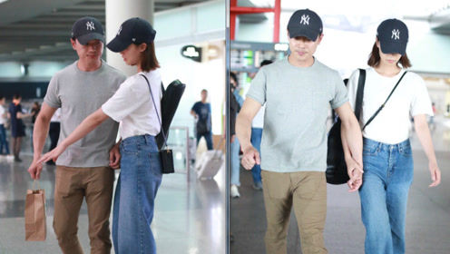 蓝盈莹与男友曹骏现身机场 手牵手一路低头无视镜头