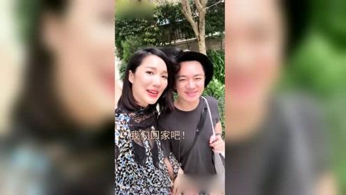 王祖蓝和老婆挽手逛街蹲地上为李亚男换鞋 穿高跟鞋的他好伟岸