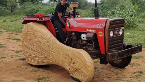 用胶带将拖拉机轮胎粘起来,拖拉机还能开吗?网友:不愧是大力士