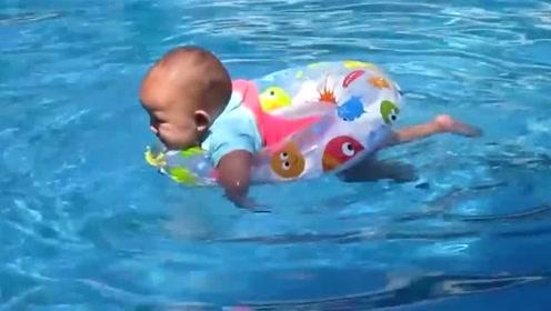 五个月宝宝去游泳,抖动着肉嘟嘟的双腿游来游去,实在太可爱了