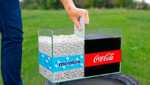 将可乐和曼妥思放入玻璃缸,扯开隔板后,反应剧烈爆发!