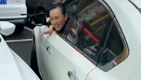 劝她停那别动了,等旁车走时谁刮到谁负责,大家觉得这样对吗?