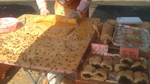 大妈街头专注做小吃,蜜蜂袭来面不改色,网友:不敢靠近!