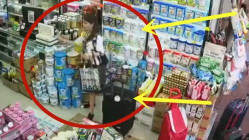 性感少妇提超大购物袋进店购物,不料竟趁人不注意,做出这事!