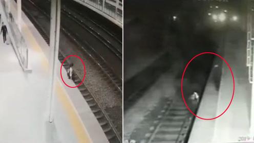 """监拍:女子径直跳下站台 值班员上演""""生死50秒""""救援"""