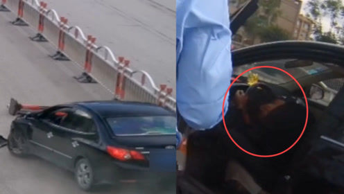 实拍:云南一醉驾司机撞两处护栏后大睡 被交警找到时叫都叫不醒