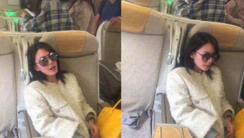 张雨绮飞机上被偶遇,素颜难掩憔悴,墨镜遮挡婉拒拍照