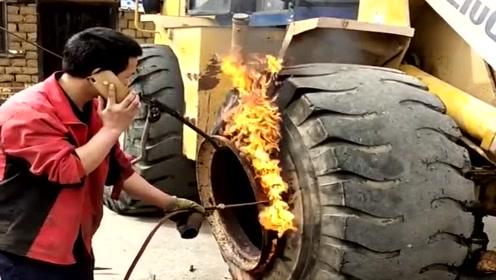 推土机的轮胎卸不下来,修车师傅直接喷火烤了,这是什么原理?