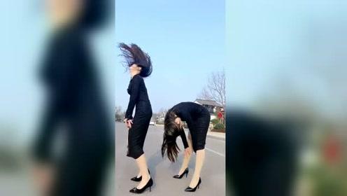 旗袍小姐姐马路上尬舞,这头发甩的很任性啊