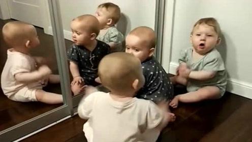 三个宝宝对着镜子搞笑,中间的宝宝长大肯定很臭美,好萌啊