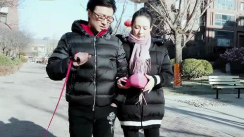 章子怡汪峰在小区内遛狗,当看清他们身上羽绒服价格后,网友炸锅