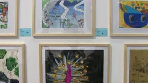 1第七届小手传大爱国际公益书画展在京举行