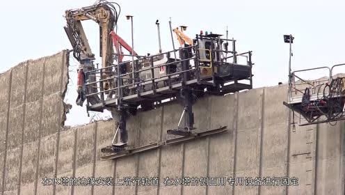 """这是什么机器?骑在水塔上""""啃""""墙壁,看着有点像寄生虫!"""