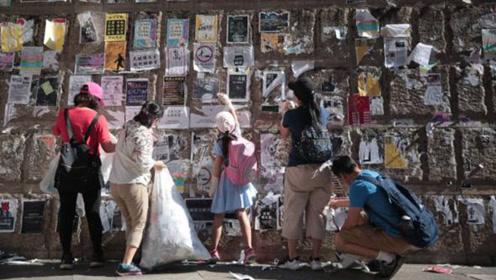 """何君尧发起""""清洁香港运动"""" 市民带子女参与清理示威者标语"""