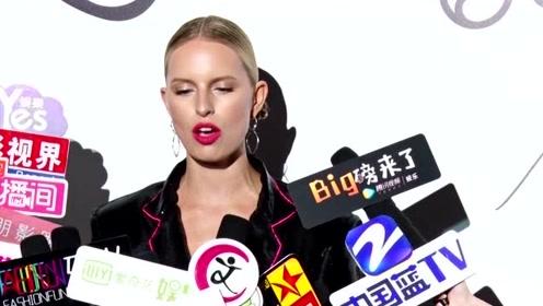 超模KK红唇造型吸睛  跨界设计注入育儿新活力