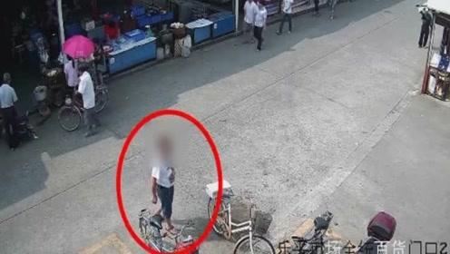 丢人!男子在菜市场偷猪肉 监控拍下全过程