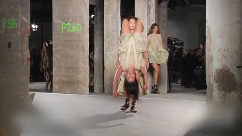 当个模特都是体力活啊 穿这个衣服出门 还得背个人吗