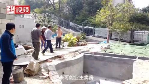 不要建了!杭州某排屋业主占用小区绿地建水池被街道现场叫停
