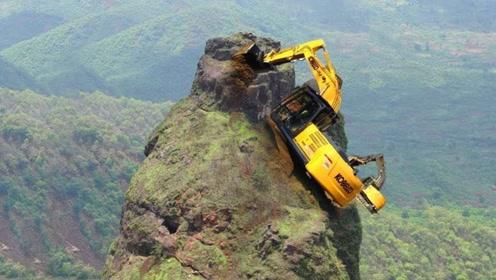 修悬崖上的盘山公路,挖掘机是怎么上去操作的?看得人心惊胆战
