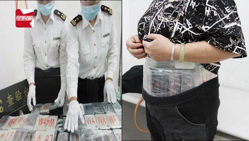 """香港旅客化身""""钢铁侠""""入境珠海,腰绑70部苹果手机被当场截获"""