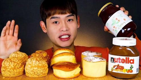 韩国小哥吃鲜奶泡芙,满满的奶油再抹上一层榛子酱,简直是太美味了!